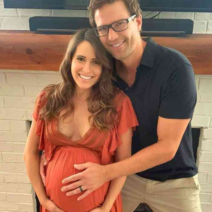 Travis Lane Stork with his pregnant wife