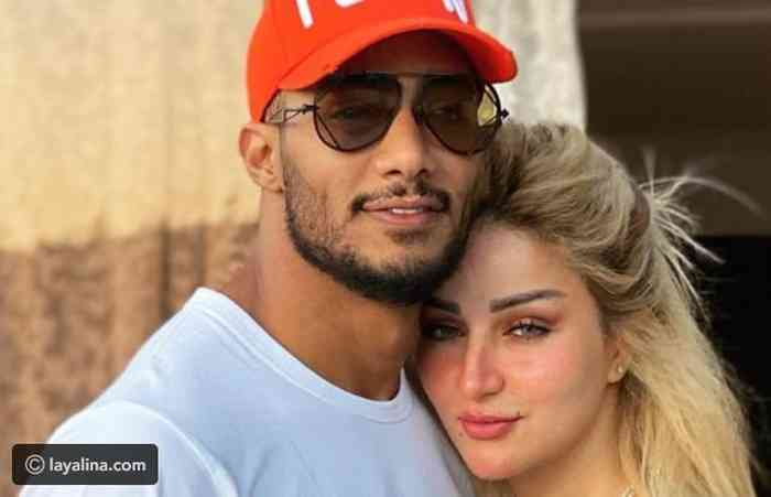 Mohamed Ramadan with his wife